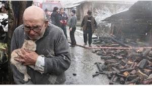 Efter at hans hus er brændt holder denne 83-årige herre godt fast på en af de sk
